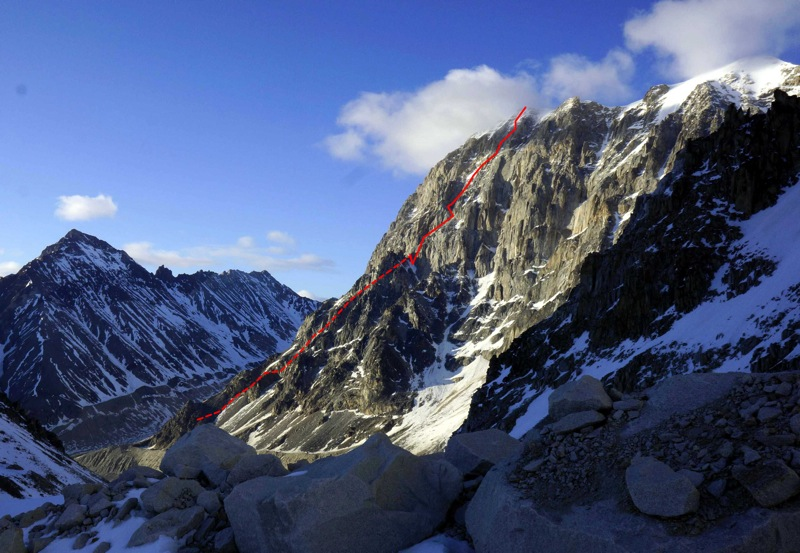 The ca 3,500' west face of Mt. Titanic in the Revelations. The new route up the west face climbed the left side of the face by the approximate line shown (the first part of the climb is out of view behind a buttress, and the climb continues up an easier snowfield to the summit).
