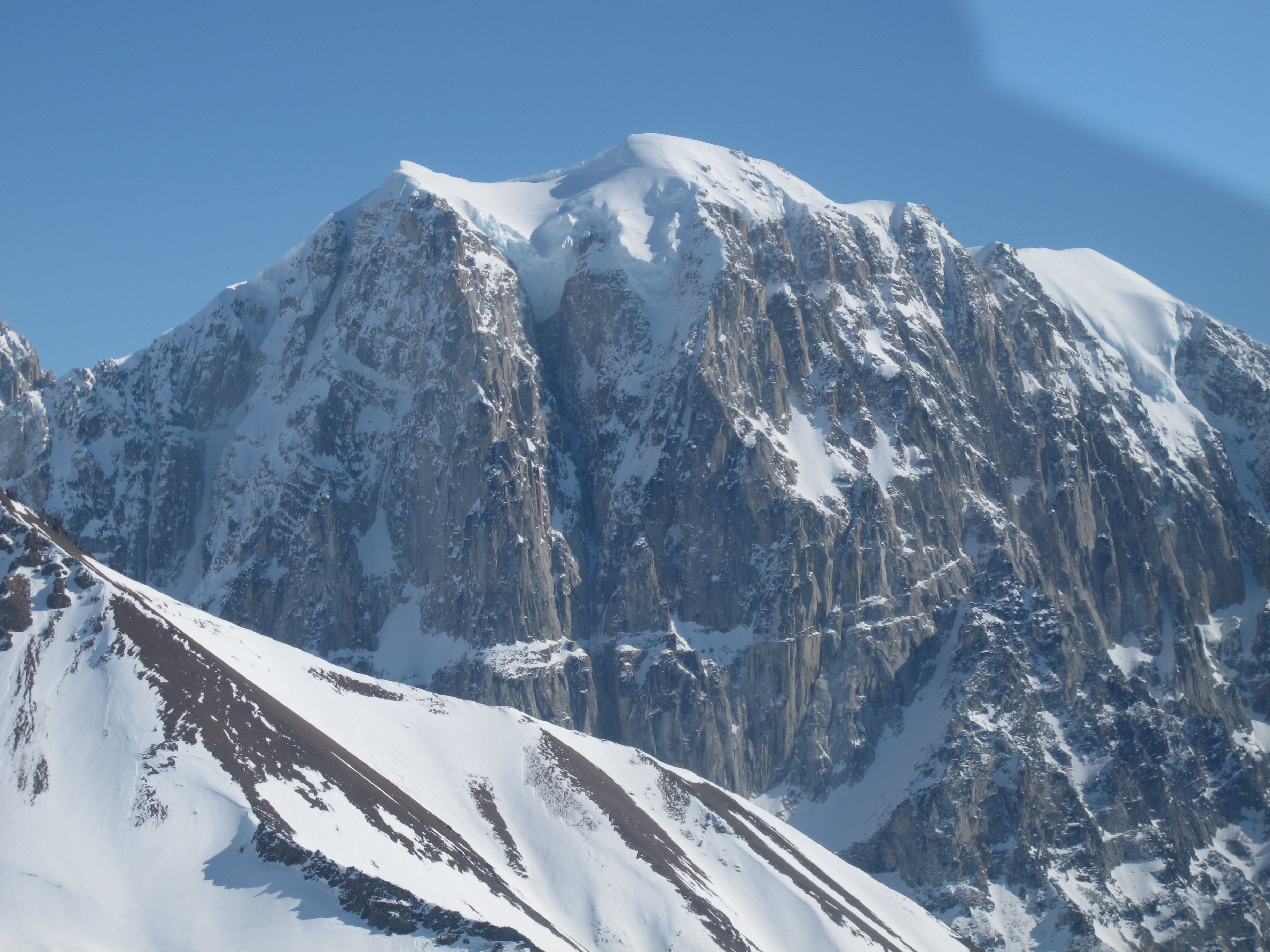 The unclimbed, ca 3,700-foot north face of Titanic (ca 9,300') on the left and the now climbed west face on the right. Fred Beckey and team made the peak's first ascent in 1981 via the east face.