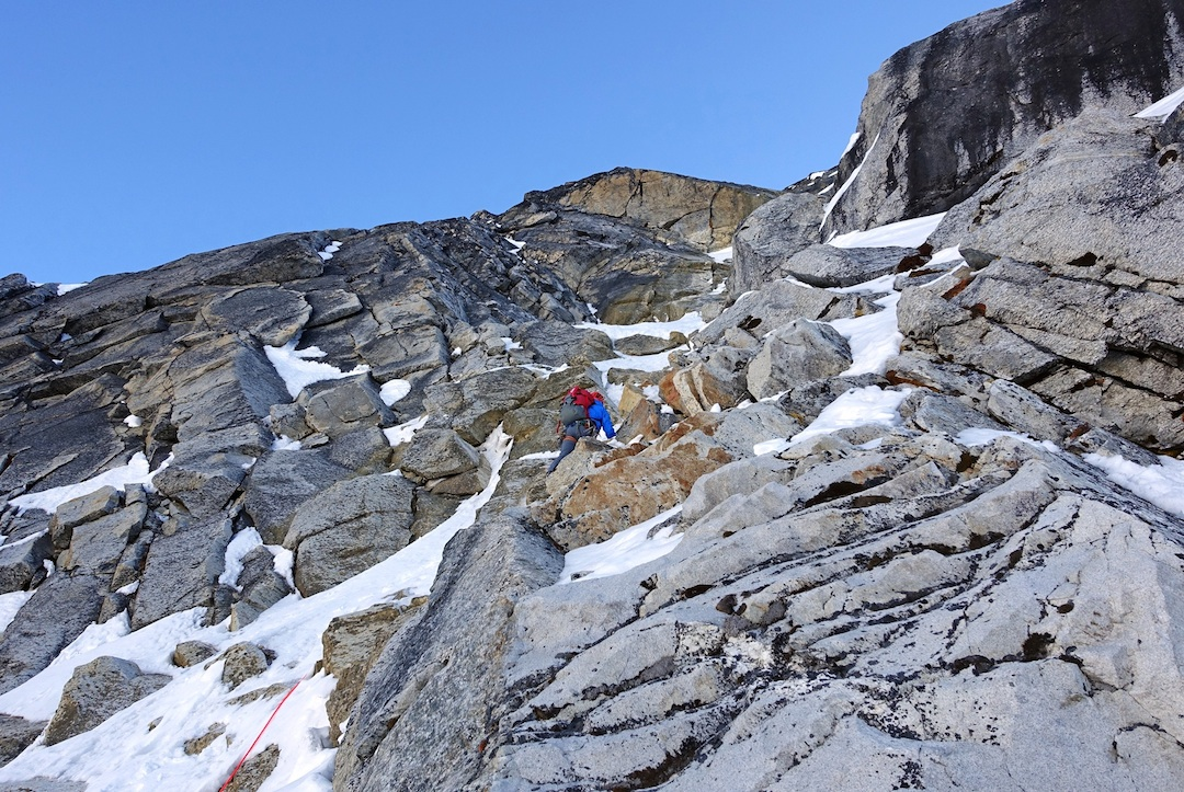 Alan Rousseau working through mixed terrain low on the west face of Parchamo.