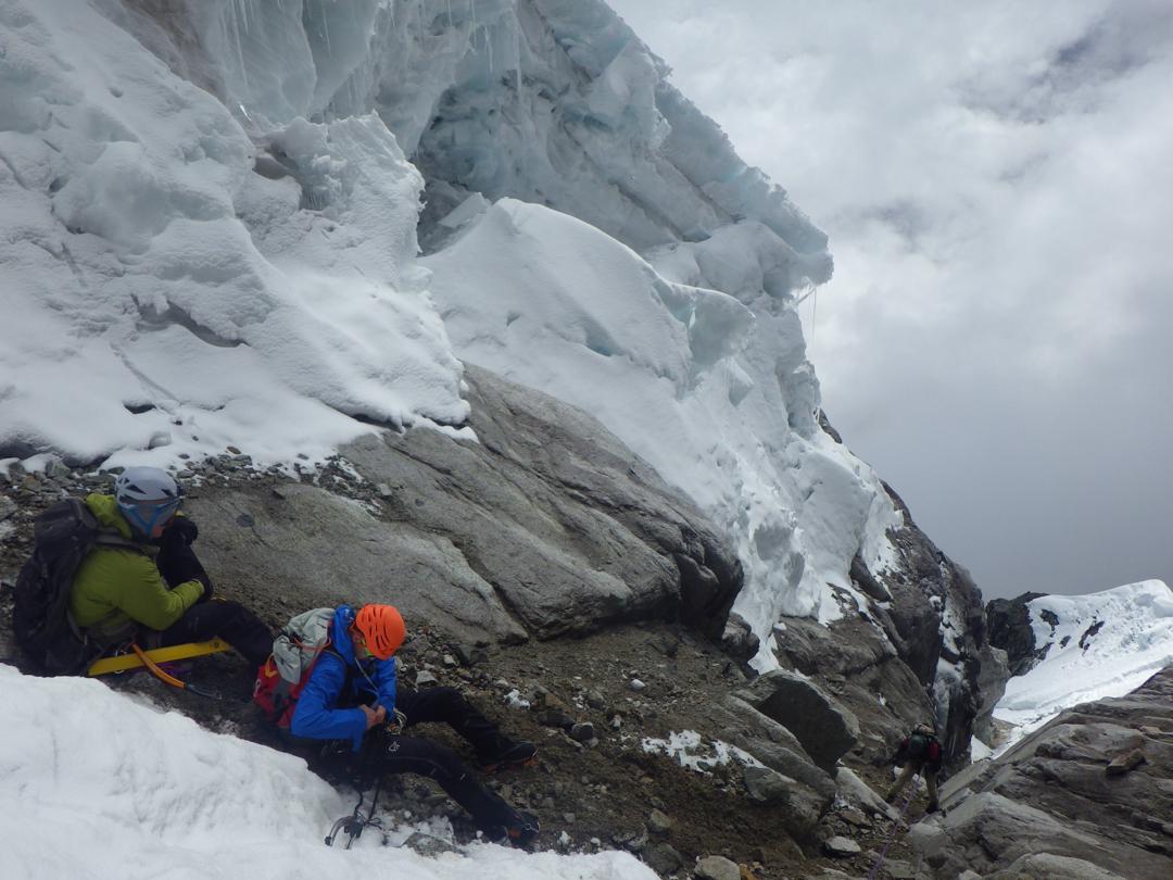 Macario Crispin rappelling the 5.7 rock chute.