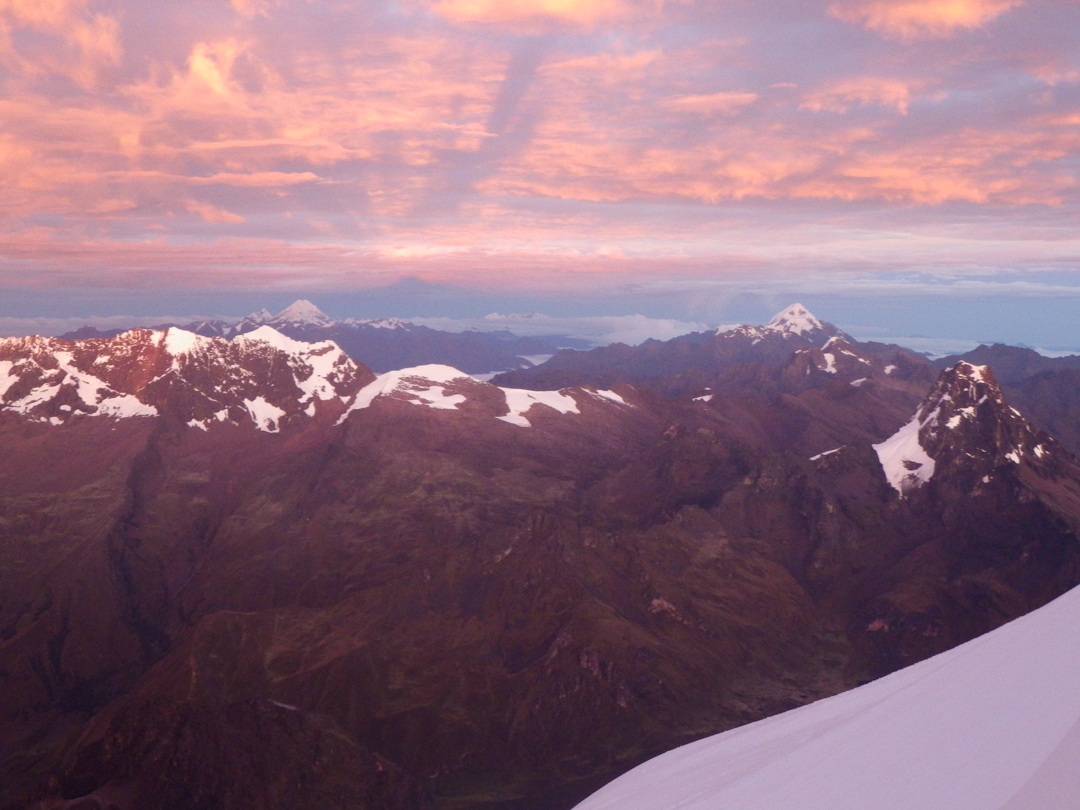 Sunrise from Nevado Sahuasiray's southwest face, with the peaks Salcantay (back left, in the Cordillera Vilcabamba), Veronica (back right), Chicon (front left), and Sirijuani (front right).