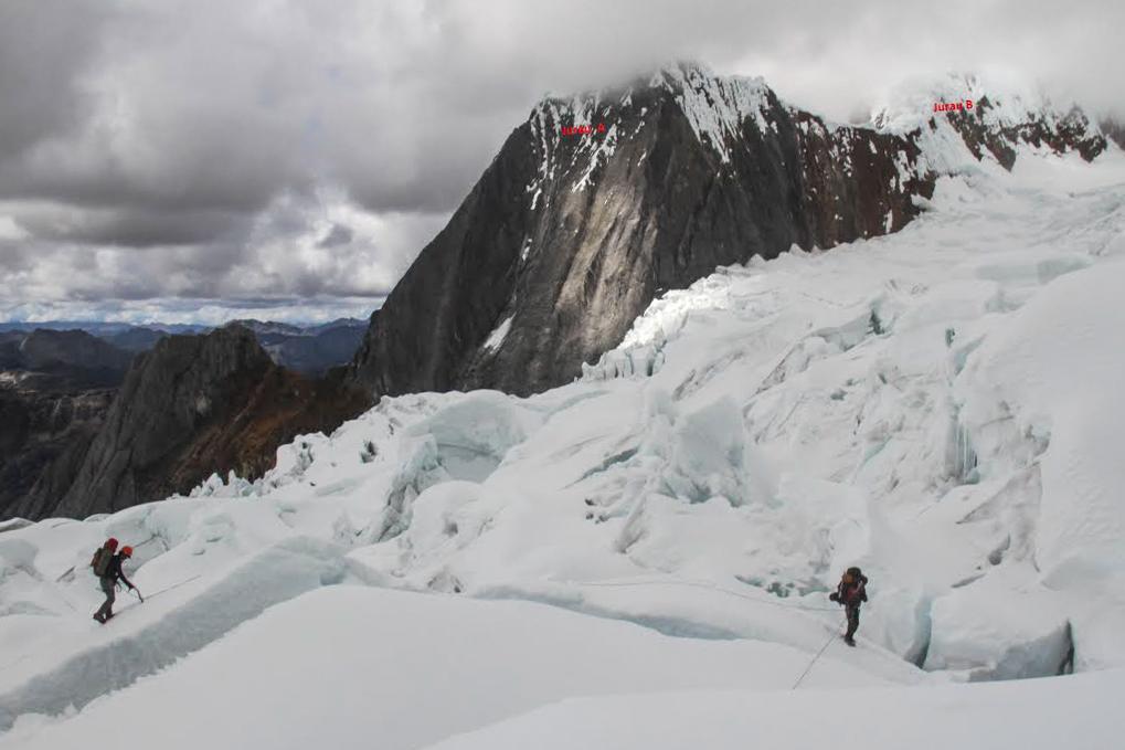 Daniel Araiza and Florian Burger make their way across the Yerupaja Glacier with Jurau A (5,617m) on the left and Jurau B (5,727m) on the right.