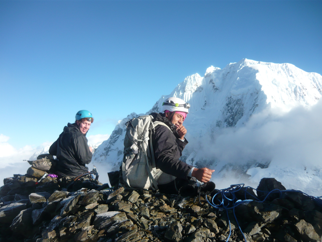 On the summit of Cerro Jatunjasa with the south face of Salcantay in the background.
