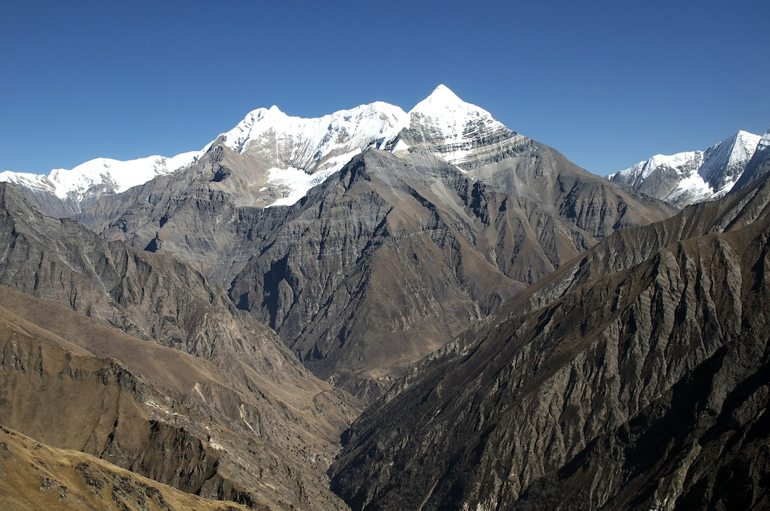 Looking northeast up the Jagdula Khola to the elegant, pointed Peak 6,294m and behind and to the left Tripura Hiunchuli (6,553m). Mountain on the far right is Shey Shikar (6,139m).