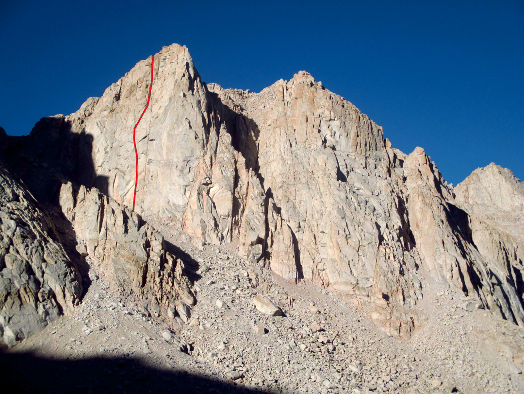 The east face of the Crabtree Crags, located above the Upper Crabtree Lake, showing the Portzline-Sinner (700', III 5.10-). The one other reported route on these formations is the Harden-O'Brien Route (AAJ 1993), which likely starts a few hundred feet right of the line shown.