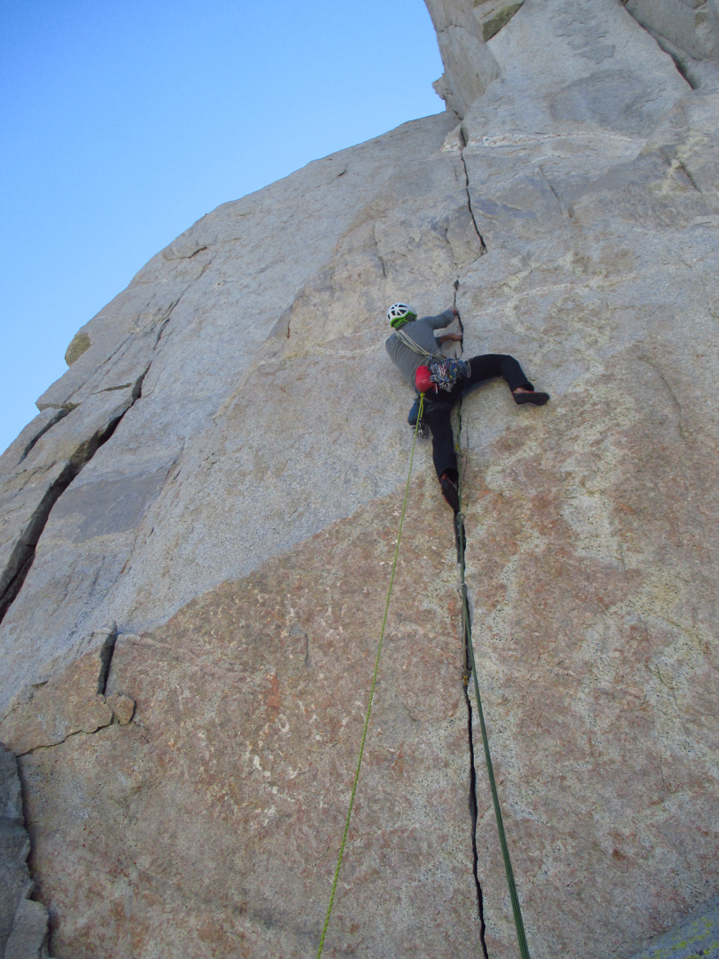 Scott Sinner leading the seventh pitch of Skinny Girls (1,000', IV 5.11 C1), on an unnamed 1,000' wall above the Lower Crabtree Lake.