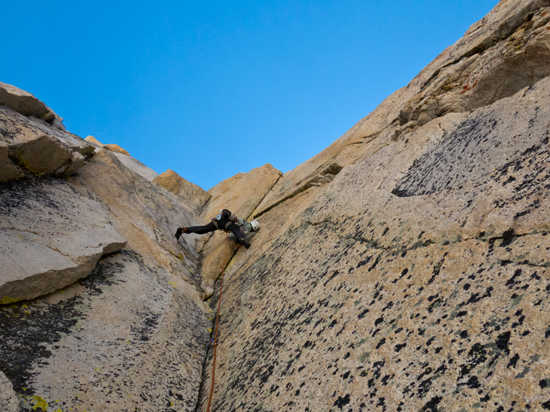 Nate Greenberg leading pitch three of the Dihedral Route (III 5.10) on the Juggernaut.