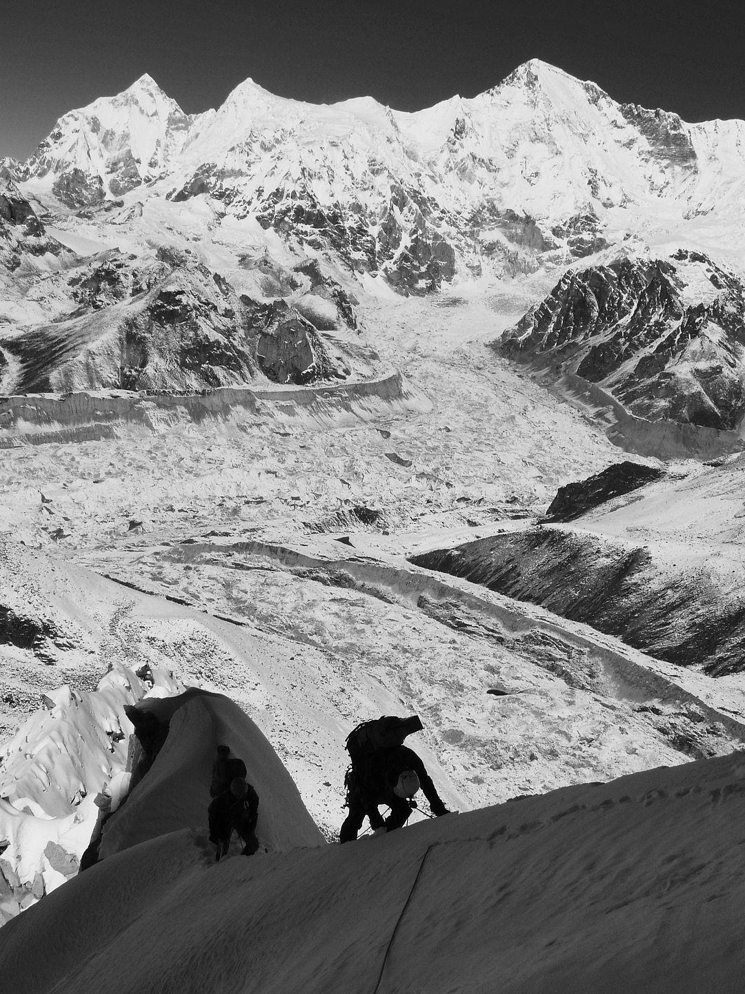 On the upper west ridge of Kangcho Nup, with the Gyubanare Glacier directly below. Behind and to the northwest lie the Ngozumba Glacier and, from left to right, Pasang Lhamu Chuli, the Nangpai Gosum peaks, and Cho Oyu.
