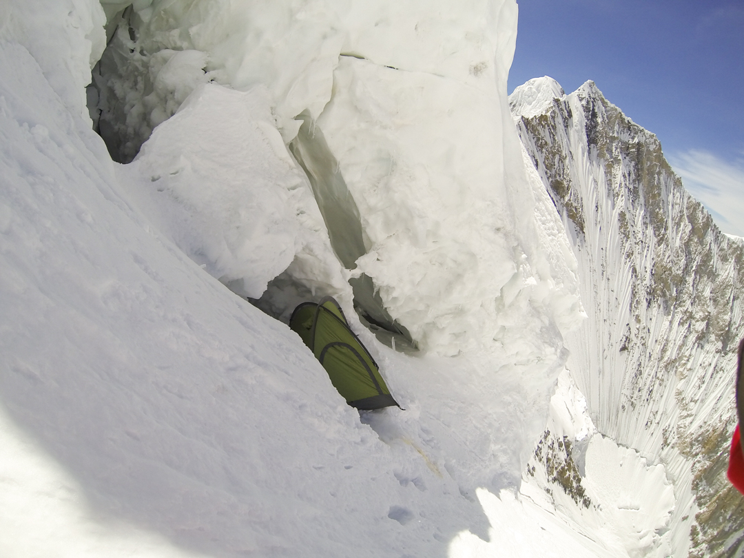 The 6,560-meter camp on Gasherbrum V's south face. The climbers spent two nights here during the ascent and one night on the way down. Behind: the northeast shoulder of Gasherbrum VI.