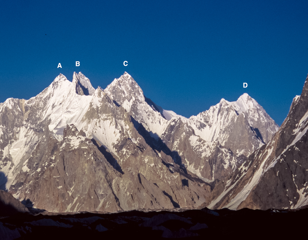 Although dwarfed by neighboring Gasherbrum IV (just out of photo to the left) and by several nearby 8,000ers, the 7,000ers of the Gasherbrum group are impressive peaks, mostly unclimbed. Seen here from the west: (A) Gasherbrum VII (6,955m, unclimbed). (B) Gasherbrum Twins (6,882m, unclimbed). (C) Gasherbrum V (7,147m), first ascent in 2014 by the shadowed face hidden at right. (D) Gasherbrum VI (7,003m, claimed in 1986 but disputed).