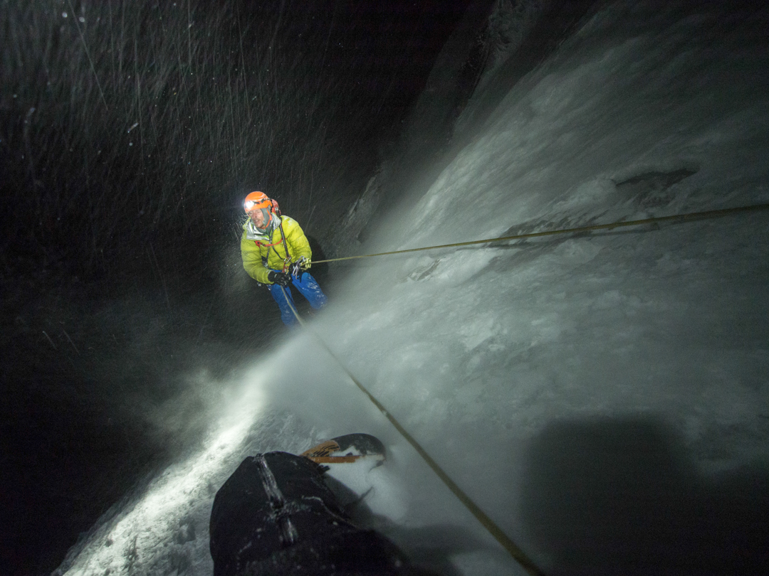 With a clever system for rapid rappels, the team's nighttime descent of the nearly 900m face took only three hours.
