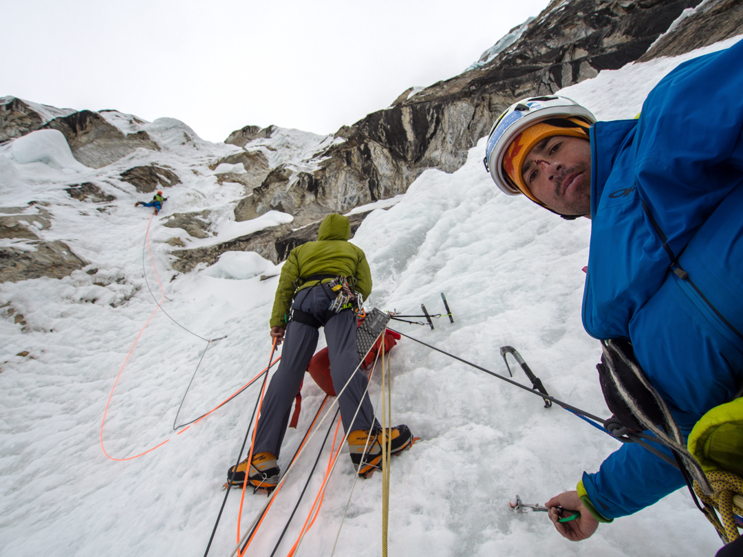 Tackling a steep ice pitch on Looking for the Void, Siula Chico.