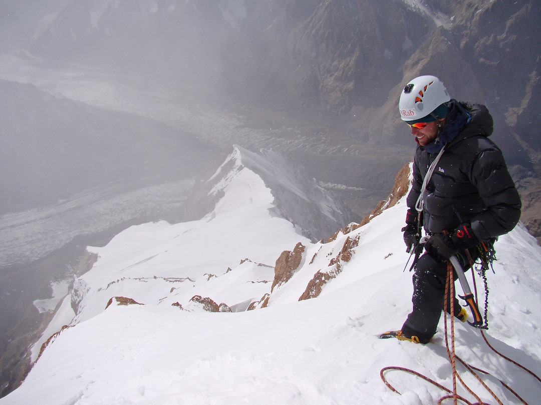Looking down the west ridge from the summit of Dankova. The original route followed the sharp crest from near its base. In 2014 the Dutch climbers came up from the left and joined the original line high on the mountain.