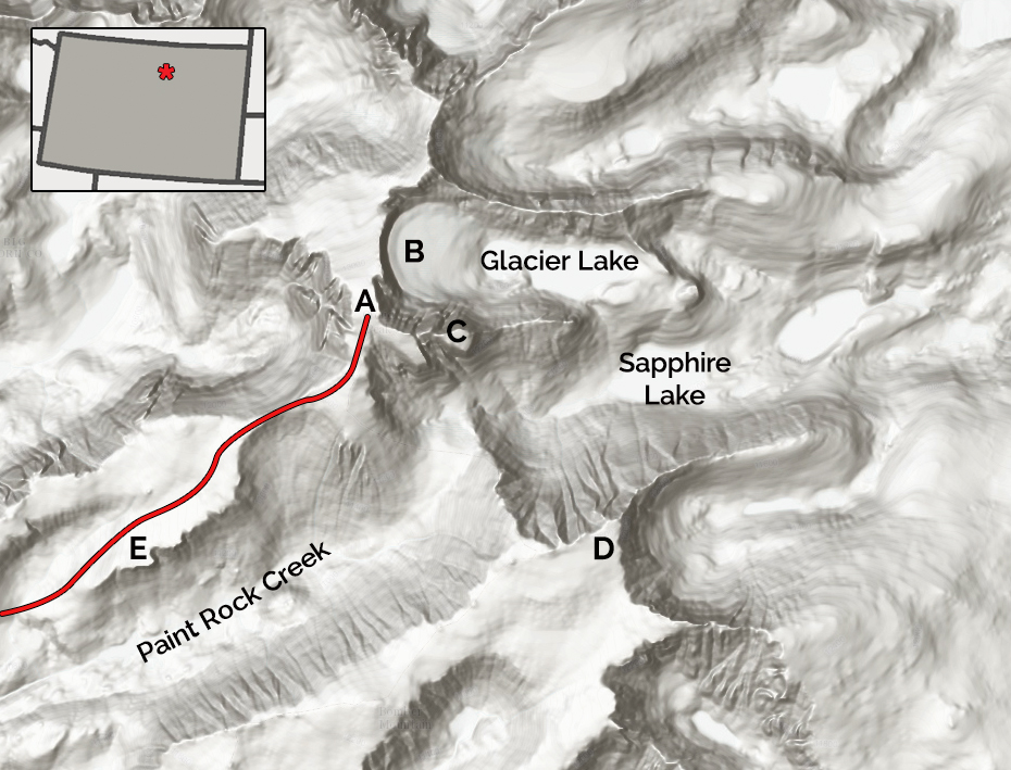 Cloud Peak's summit is about 12 miles from the road. (A) Cloud Peak, with the southwest ridge hiking route marked. (B) East face. (C) The Merlon. (D) Bomber Mountain. (E) Paint Rock Buttress.