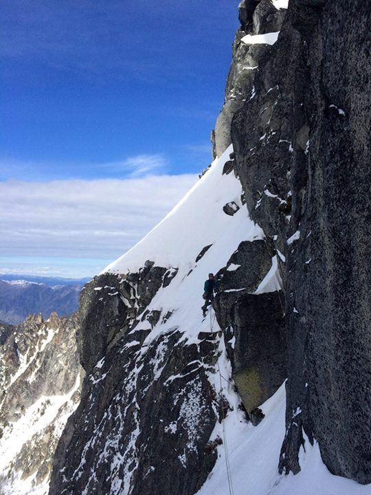 On the fifth pitch, climbing left from the corner system to reach better ice and rock.