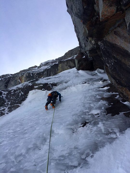 Leading a thin slab of ice on the opening pitch.