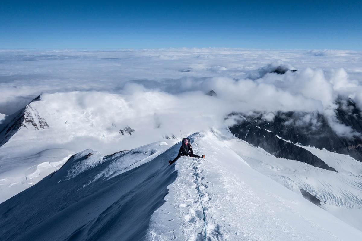 Ryan Wichelns on the summit of Mt. Silverthrone.