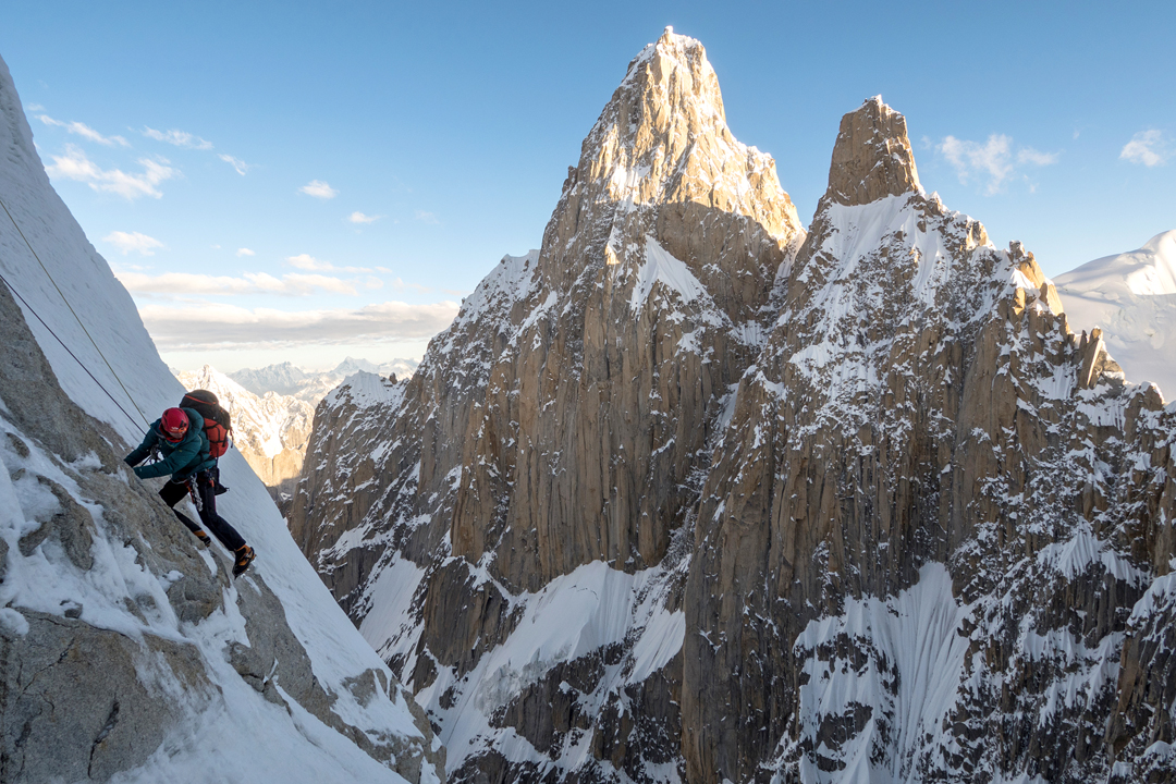 Andy Houseman on the northwest face of Link Sar, with K7 behind. A route up the couloir between the two rock spires, and then up and left to the summit, was climbed in 2012 by Kyle Dempster, Hayden Kennedy, and Urban Novak.