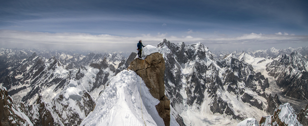 Jon Griffith atop Link Sar West with K6 behind, and to the right and more distant the snow pyramid of Drifika.