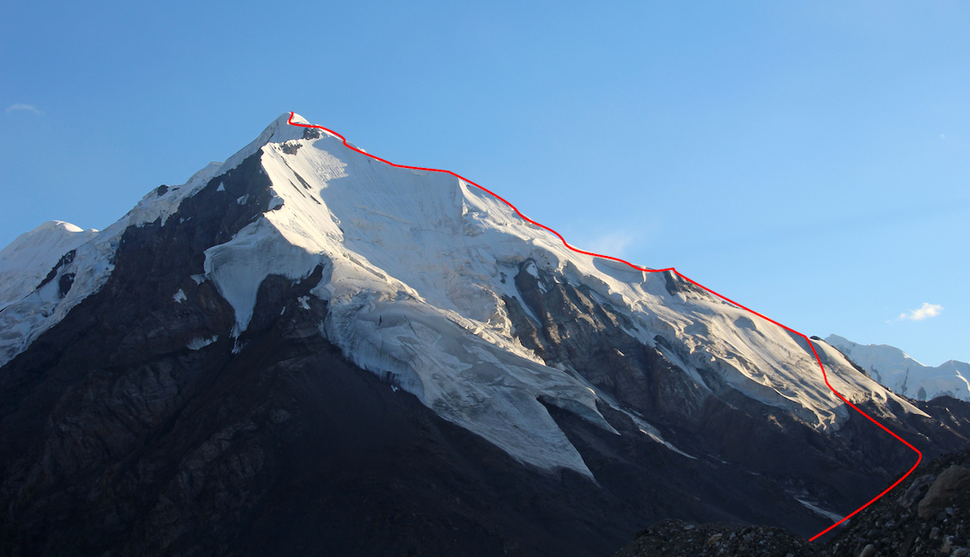 Pik 5,023m and the route of ascent seen from the northeast. The abrupt serac wall is visible just below the summit. Camp was made at the point where the route reaches the skyline ridge.