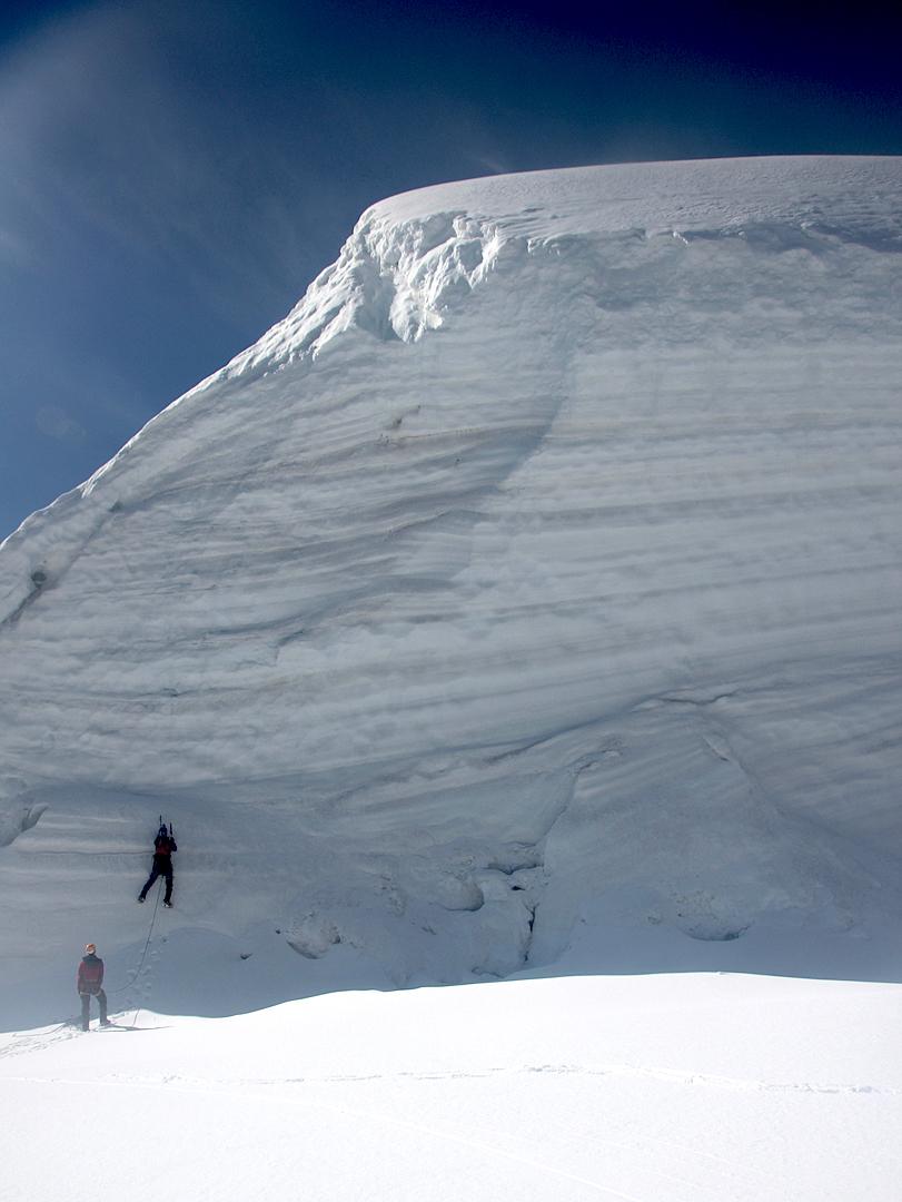 Will Kernick starting up the serac wall just below the summit.