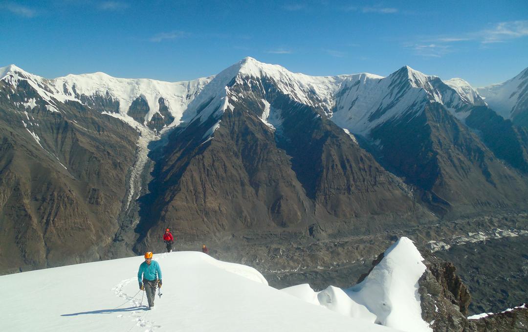 Nearing the summit of Pik 5,023m, with the North Inylchek Glacier below and, from left to right, Pik Piramida (5,332m), Pik Ignateva (5,488m), and Pik Panoramnyi (5,300m).