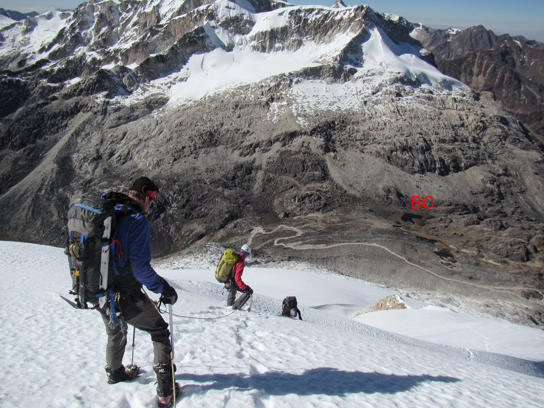 Descending from Peak 5,694m, with the road over Kasiri-Calzada Pass and base camp (BC) visible below, and the Calzada massif on the far side of the pass.