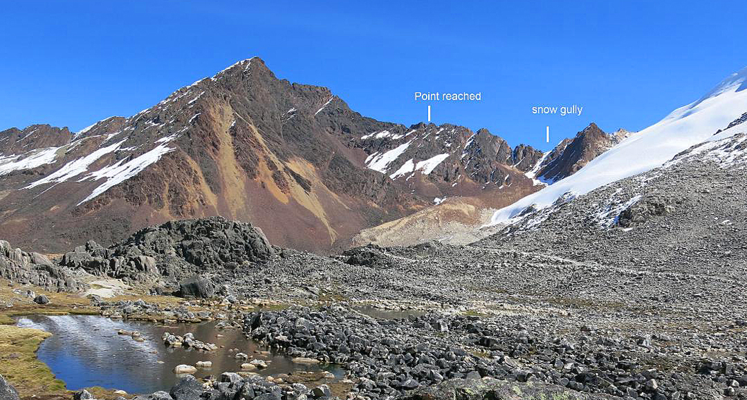 Kasiri Chico (5,542m) from close to base camp by the Kasiri-Calzada Pass. The snow couloir approach and high point on the northeast ridge are marked.