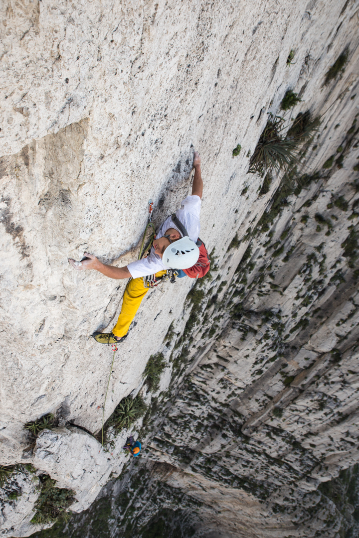 Carlos Flores climbing fine, white limestone on the Life You Can Save (350m, 13 pitches, 5.12d).