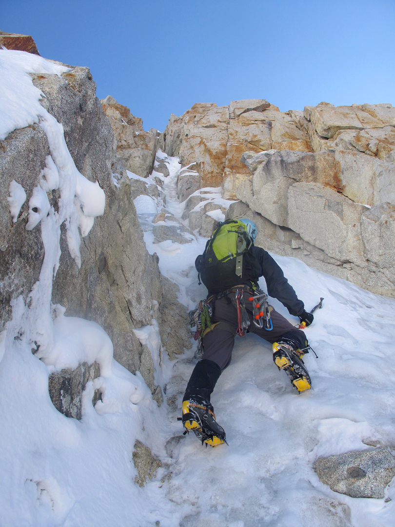 Gregg Beisly climbing toward one of the trickier sections of the gully during the first ascent of Thanks for Coming, Pico Triangular.
