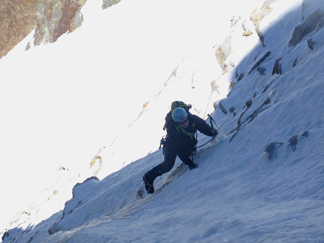 Gregg Beisly on the last few meters of snow and ice before starting the two-pitch mixed section of Thanks for Coming, Pico Triangular.