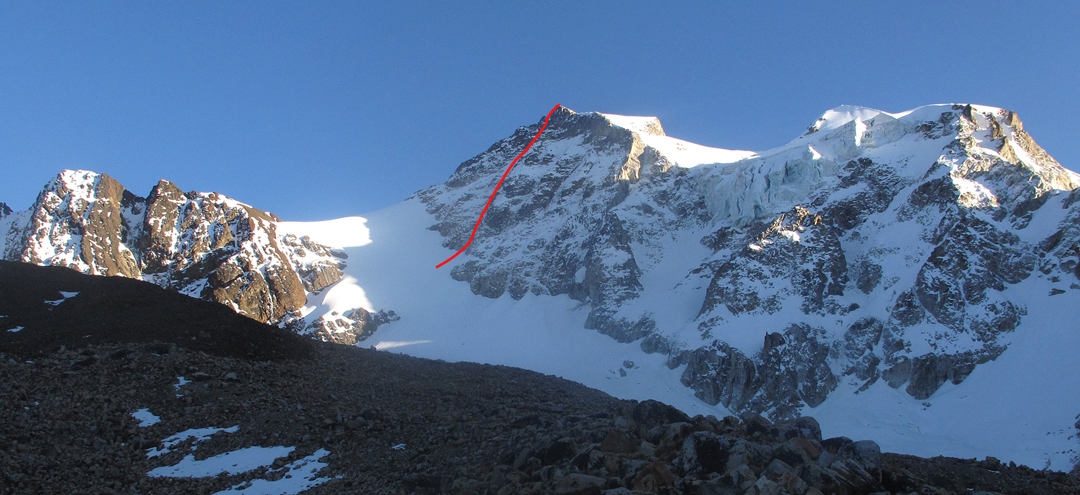Pico Triangular and, to its right, Pico Italia. Thanks for Coming on the south face of Triangular is marked. See photo in AAJ 2015 for other routes on these faces.