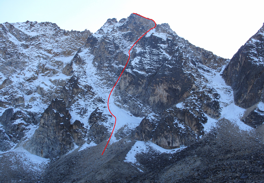 Cloudy Condors on the southwest face of the Milluni group. Pico Milluni's main (central) summit is at left, and the Central Couloir (1972) splits the two faces. From the top, the climbers descended the right skyline ridge and then came down the broad snow gully.