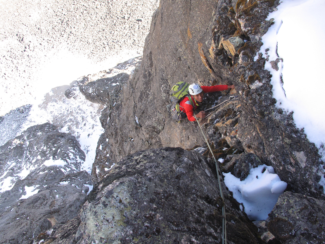 Pacifico Machara exiting the lower gully of Condores y Picaflores at the top of pitch three.