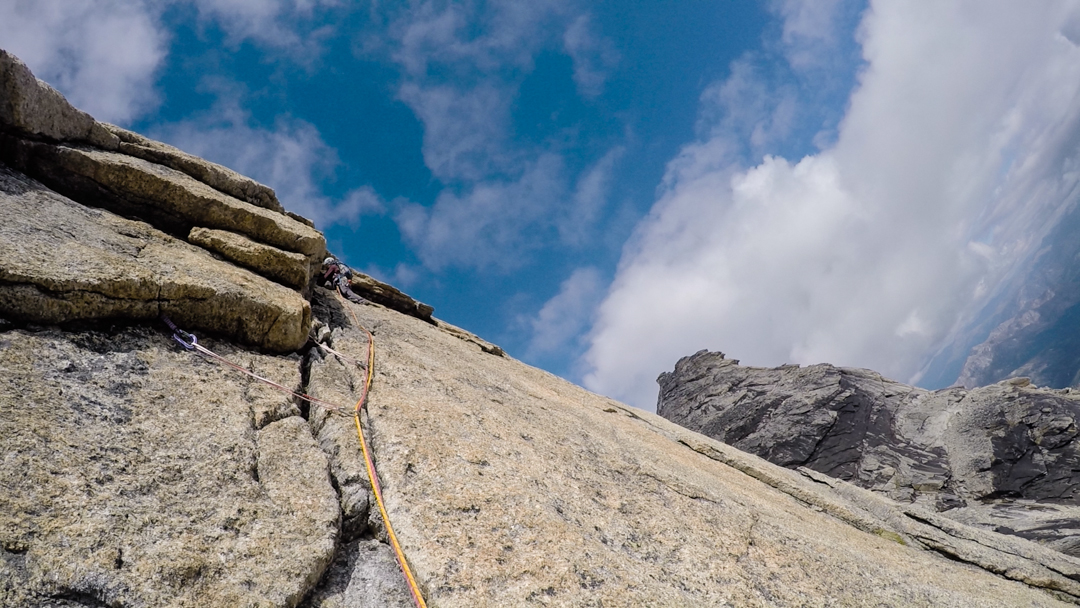 Stephanie Safdi leads up the terrific cracks of Misty Maiden on the southwest face of West Maiden.