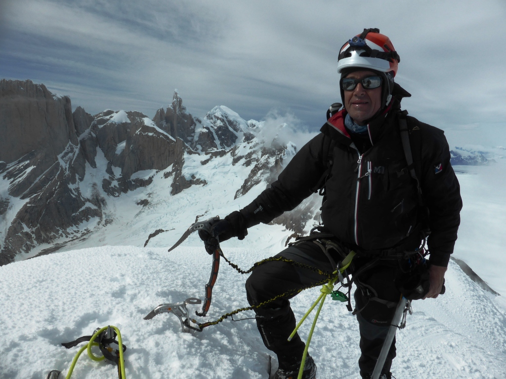 Henry Bizot on the summit of Cerro Dumbo, with the Marconi Glacier and Torre group in the background.