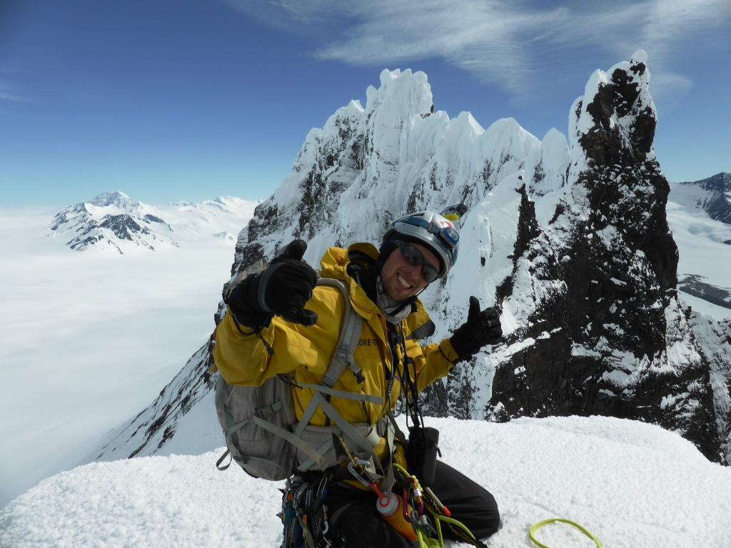 Gabriel Fava on the summit of Cerro Dumbo with the spires of Marconi Sur and the vast Hielo Continental behind.