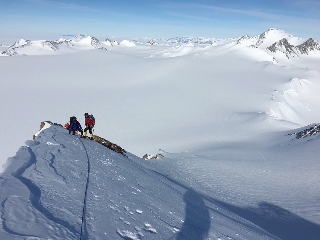 Climbers on the southeast ridge of Hall Peak during the first ascent. In the background at right is the northern side of Mt. Spörli.