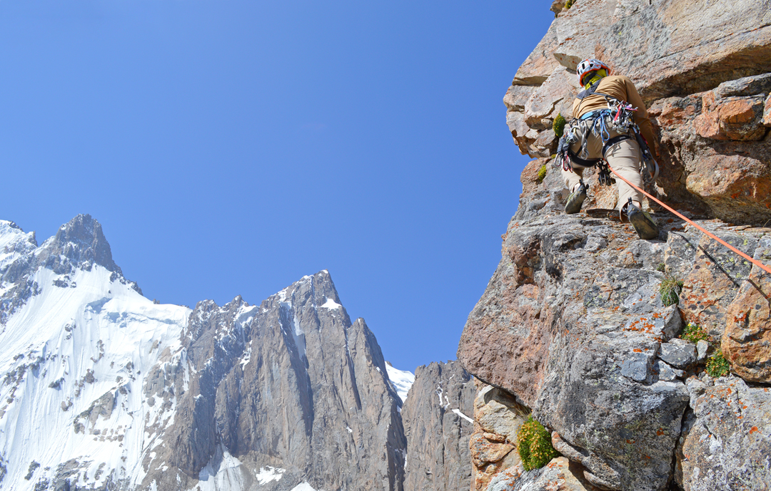 During the first ascent of the southeast ridge of Ryzhii with Sauk Dzhaylyau West II (left) and West I behind.
