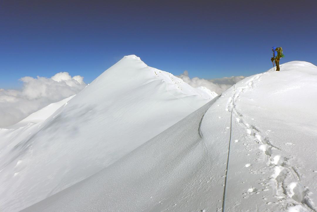 Katharina Pfnaisl looking back east to the main summit of Kurumdy during the central Zaalayskiy traverse.