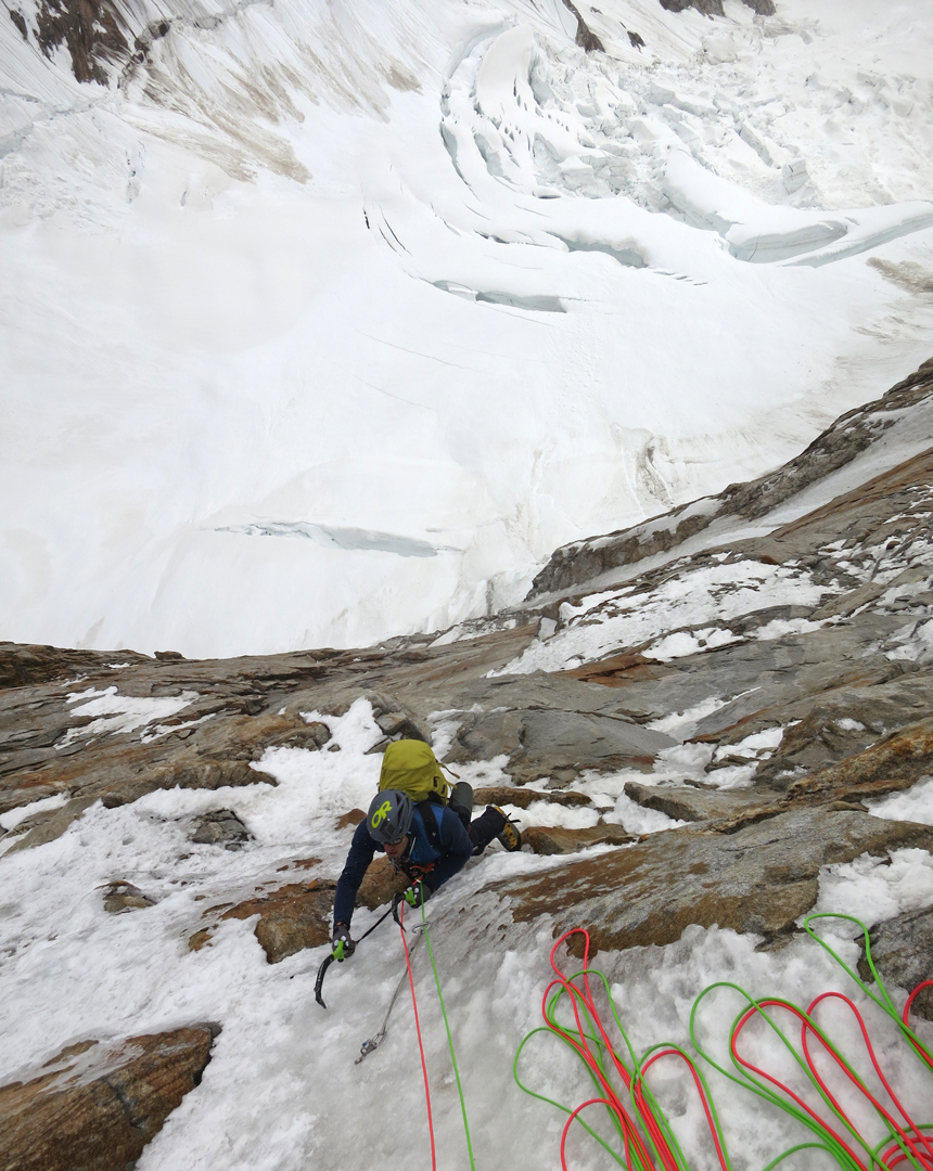 Kyle Dempster enjoying nice climbing in the middle of the north face of Ogre II, with the Choktoi Glacier below.