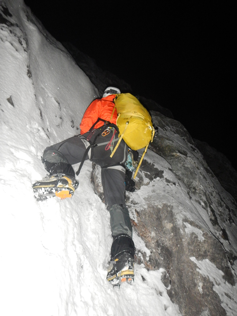 Climbing through the first rock section on the north-northeast face of Urkinmang.