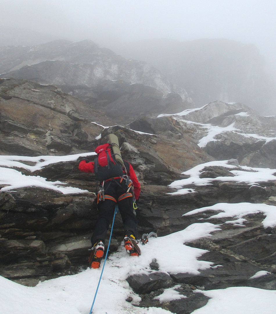 Climbing into the mist on the northwest face of Peak 6,071m.