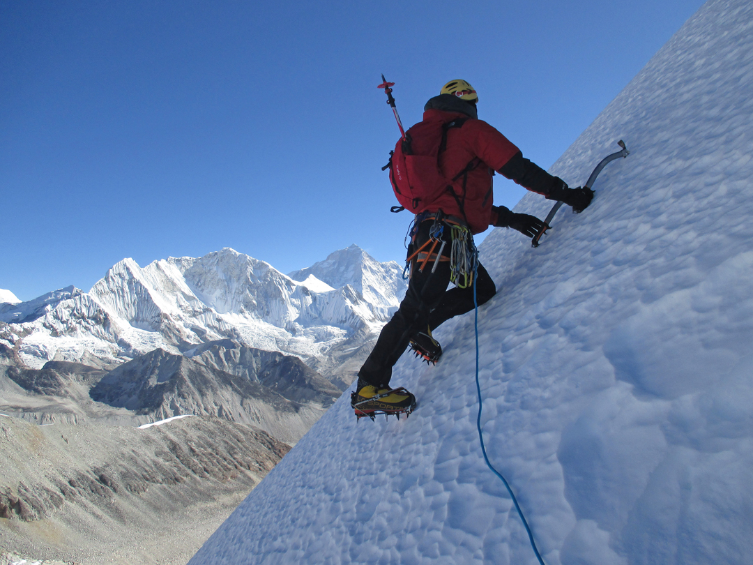 On the upper section of the north-northeast ridge of Peak 6,420m with Makalu in the background.