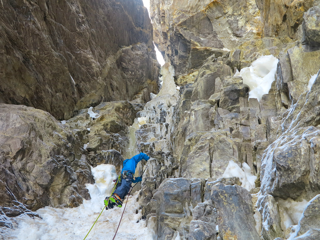 Cosmin Andron starting the difficult ice pitch above the first bivouac in the T16 Supercouloir.