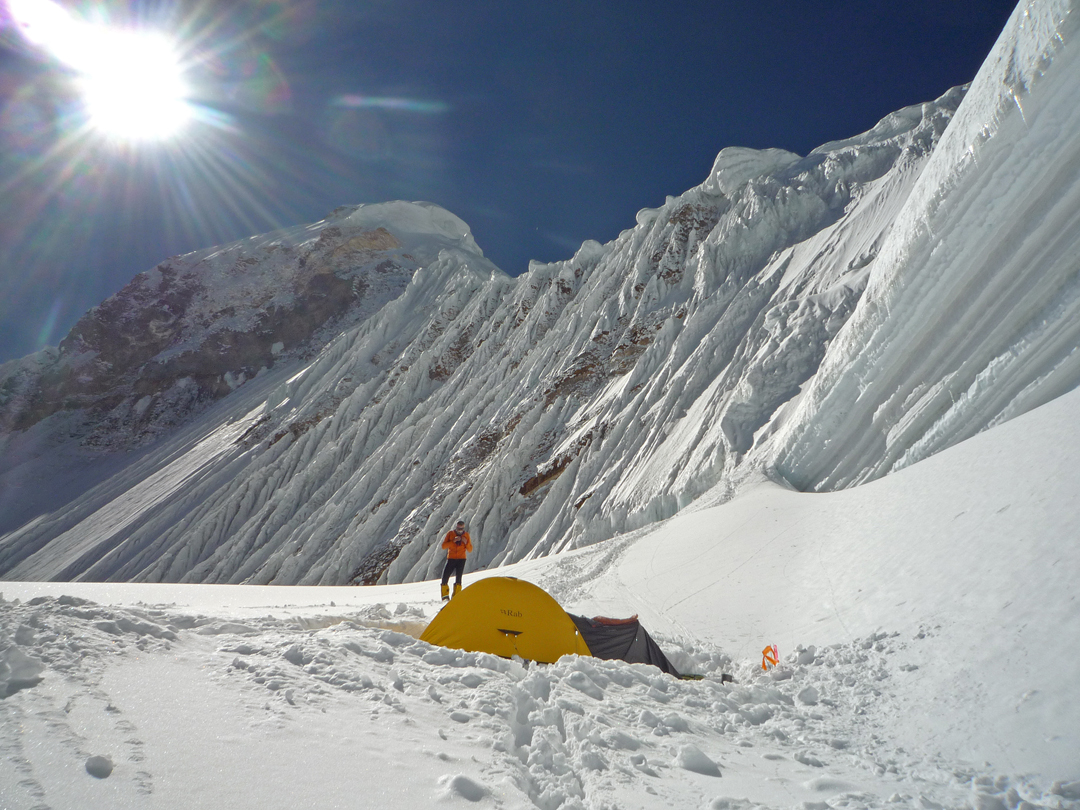 Top camp at 6,640m on the northeast ridge of Nanda Devi East. The fluted upper ridge and summit seracs are above. The high point was the large mushroom/cornice toward the near end of the ridge.