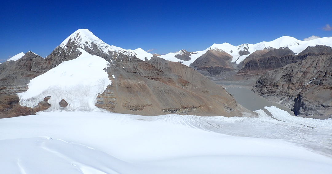 Looking due north from the summit of Dzanye II to a peak above 6,600m in Tibet.