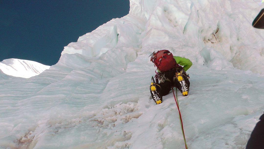 Climbing through the ice wall on the first ascent of Thulagi.