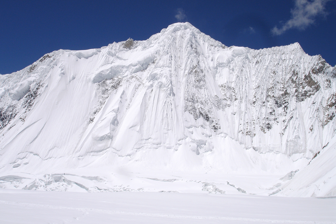 The unattempted northeast face of Gasherbrum VI below the main summit (center). The northwest shoulder is the fluted triangular point at far right. The 2009 Portuguese attempt was way off-picture to the left.