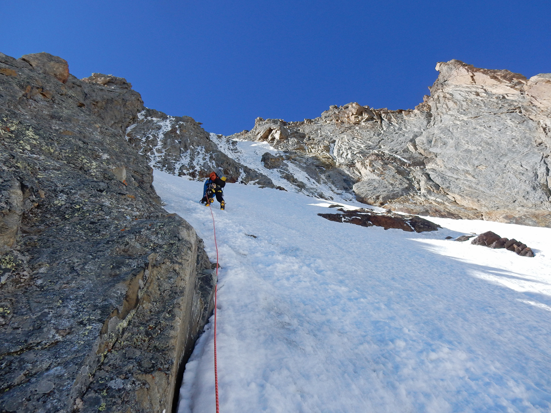 Robert Taylor approaching the bottom of the couloir on the north face of Muz Tok.